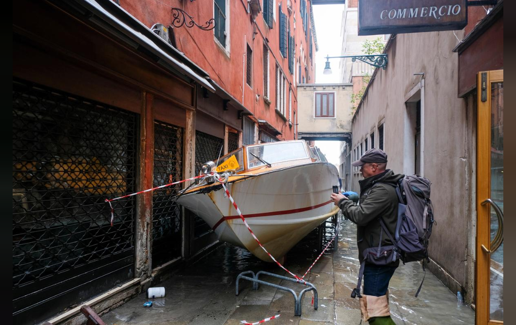 A water taxi transported by the water into a street after a night of record-high water levels is seen in Venice, Italy November 13, 2019.