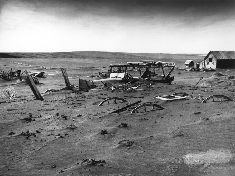 Farm machinery buried in dust drifts, South Dakota, 1936.