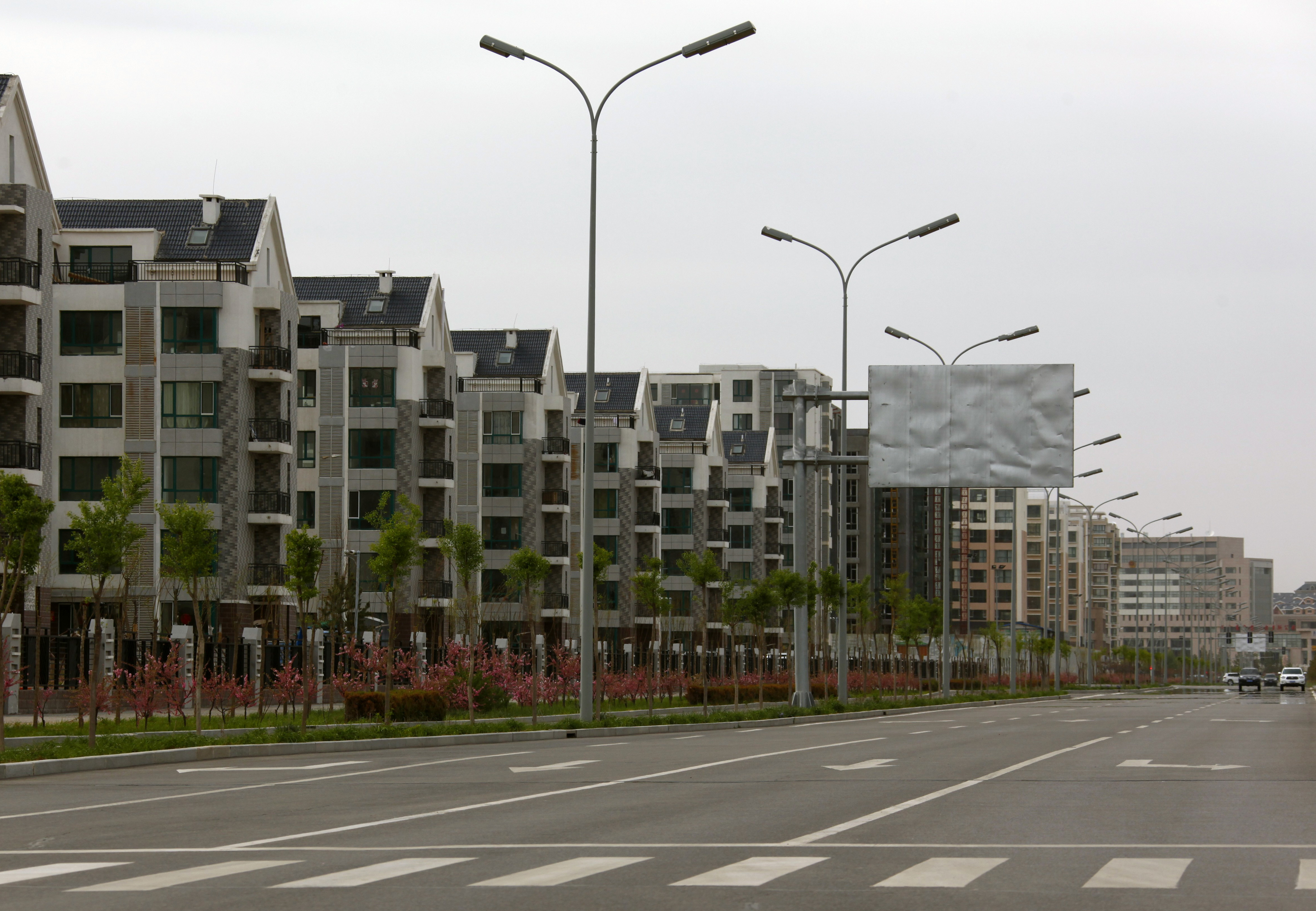 Residential homes line a deserted street in the Kangbashi district of the town of Ordos in China's Inner Mongolia Autonomous Region May 11, 2011. About 30 km (19 miles) north of Dongsheng is the Kangbashi district of Ordos, which means