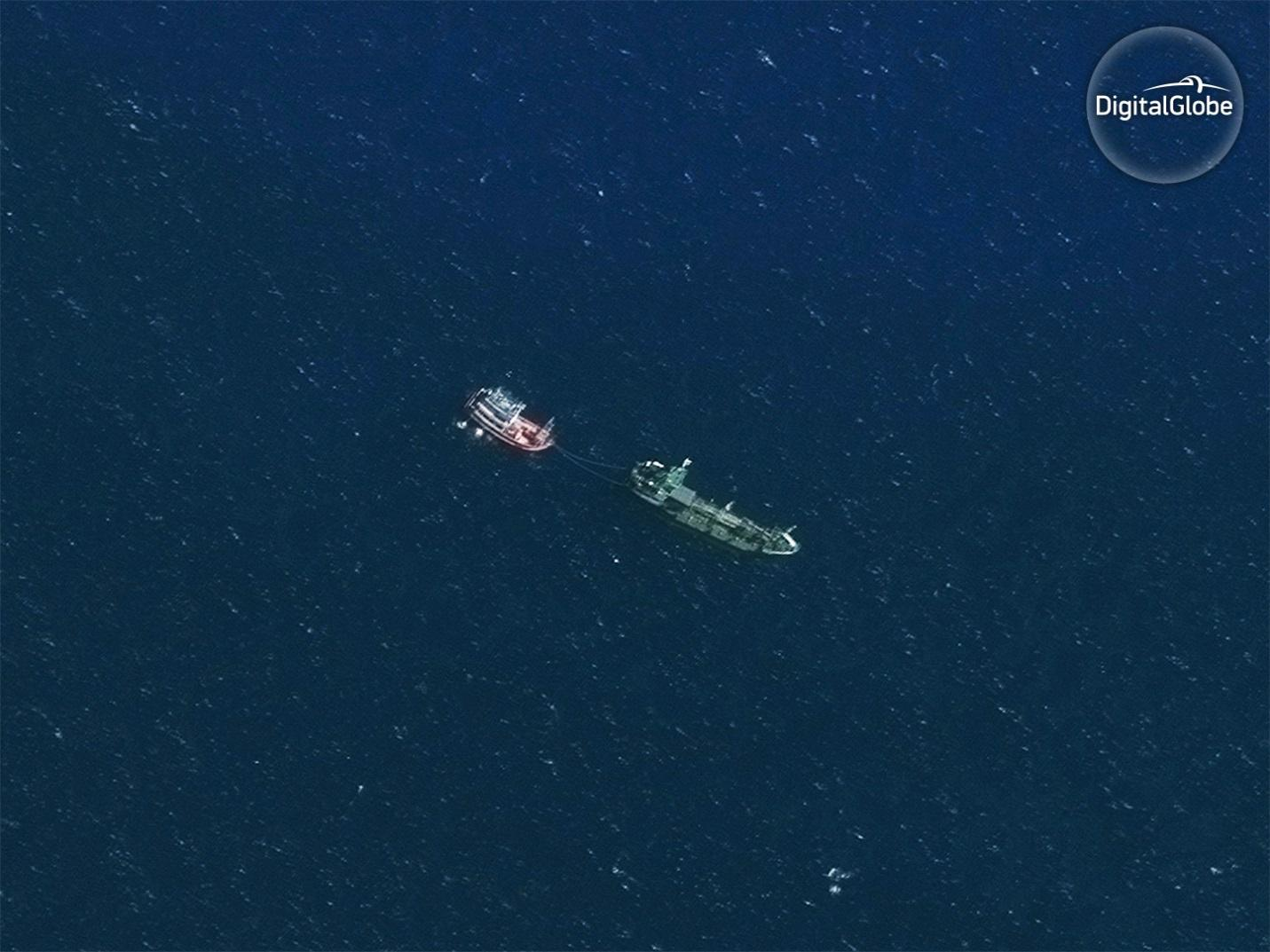 Refueling vessel, Mahachai Marine 1, with unidentified vessel tied astern. November 30, 2016