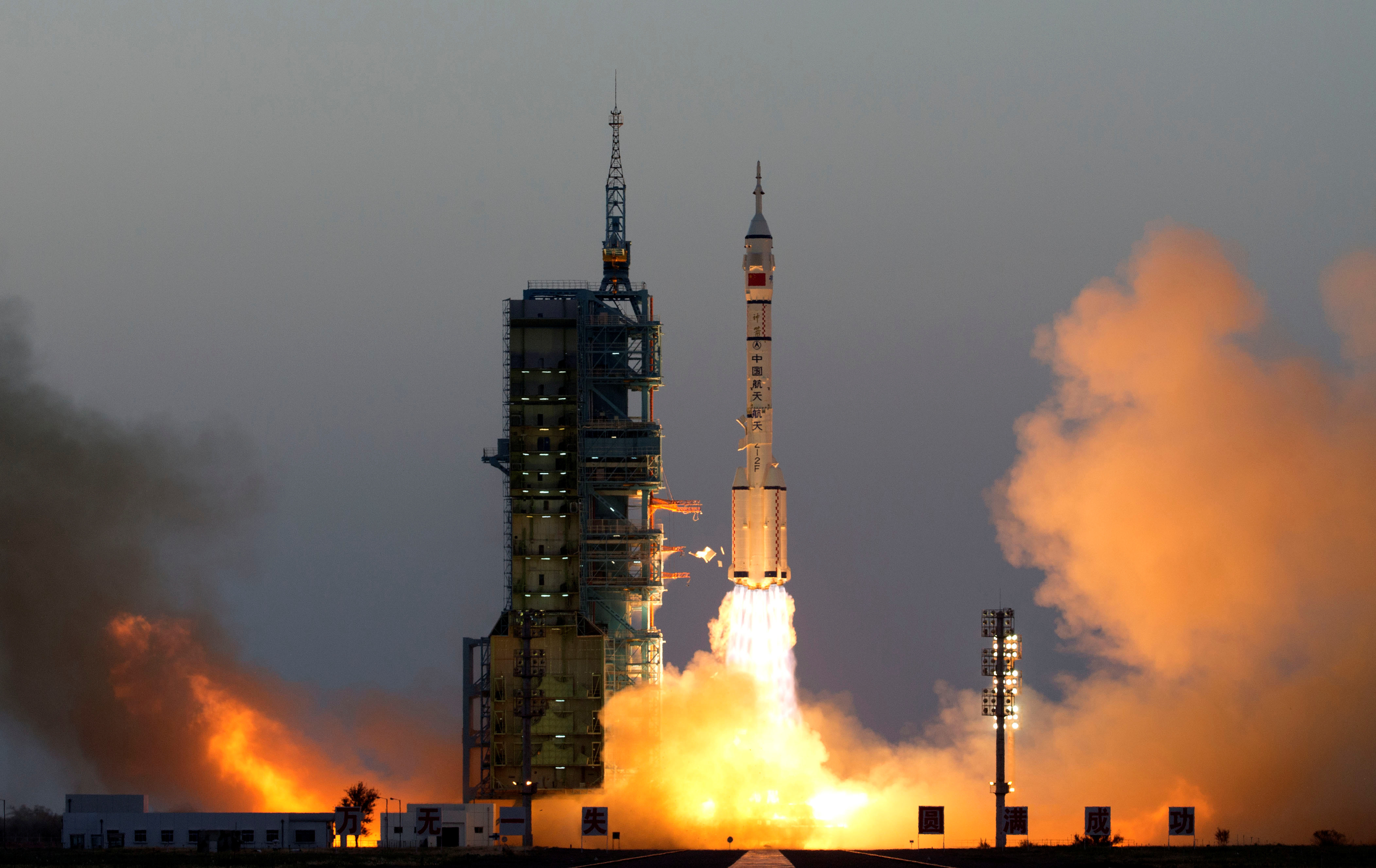 Shenzhou-11 manned spacecraft carrying astronauts Jing Haipeng and Chen Dong blasts off from the launchpad in Jiuquan, China, October 17, 2016. China Daily/via REUTERS ATTENTION EDITORS - THIS PICTURE WAS PROVIDED BY A THIRD PARTY. EDITORIAL USE ONLY. CHINA OUT. NO COMMERCIAL OR EDITORIAL SALES IN CHINA.     TPX IMAGES OF THE DAY - RTX2P2ZZ