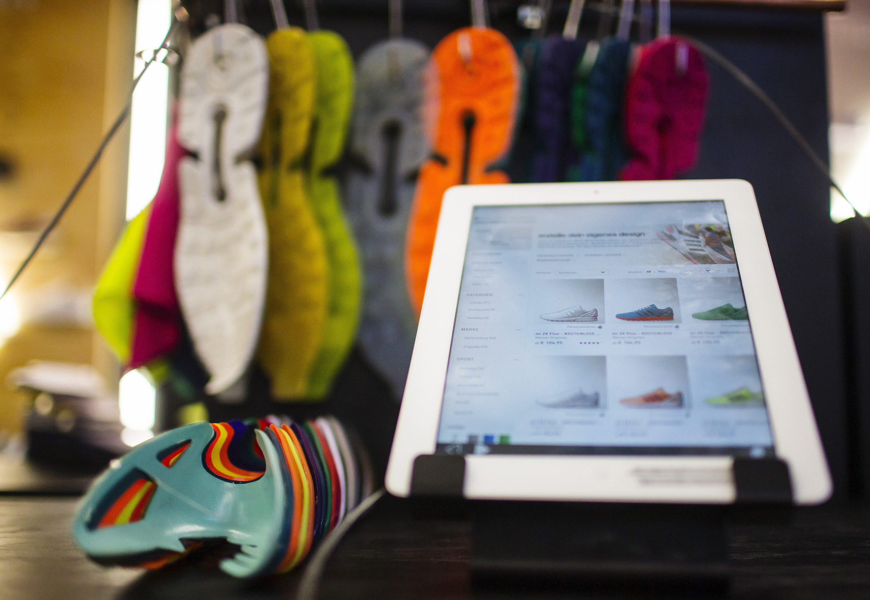 A tablet to customise sneakers is pictured in an Adidas pop-up store in Berlin December 2, 2014. Big consumer brands have latched on to personalised products because they seem to have a particular appeal to consumers known as