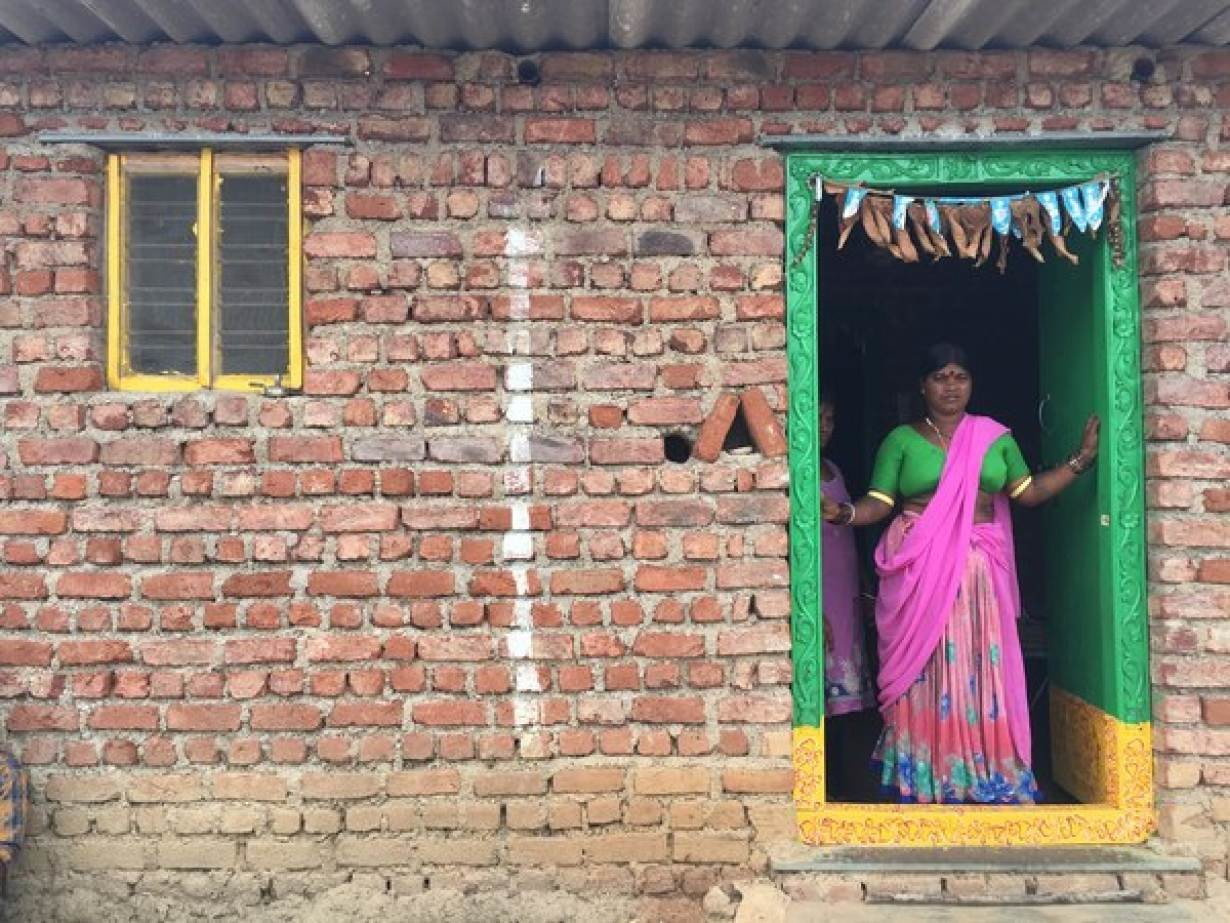 Maloth Bhuti, who underwent a hysterectomy last year, stands at the door of her house in Kowdipally, India, September 10, 2018 .