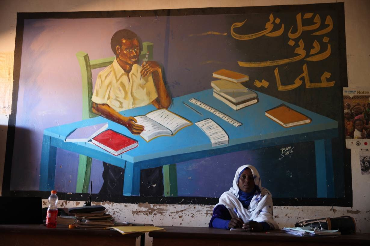 School director Fathya Ali Souleymane poses for a portrait in her office in Touloum refugee camp in Iriba, Chad, November 27, 2019.