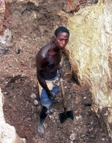 A miner with body scars works at Gecamines concession near the centre of Lubumbashi, DRC.