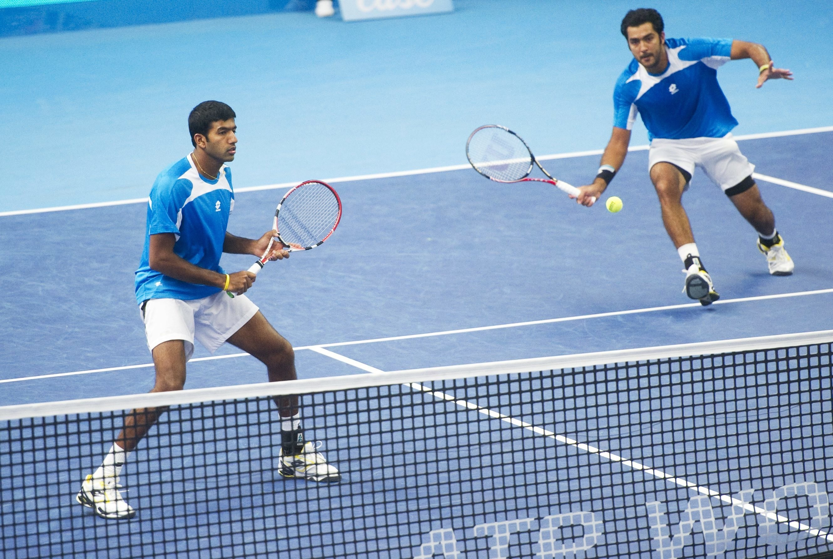 The Indo-Pak Express in action … Bopanna, left, and Qureshi.
