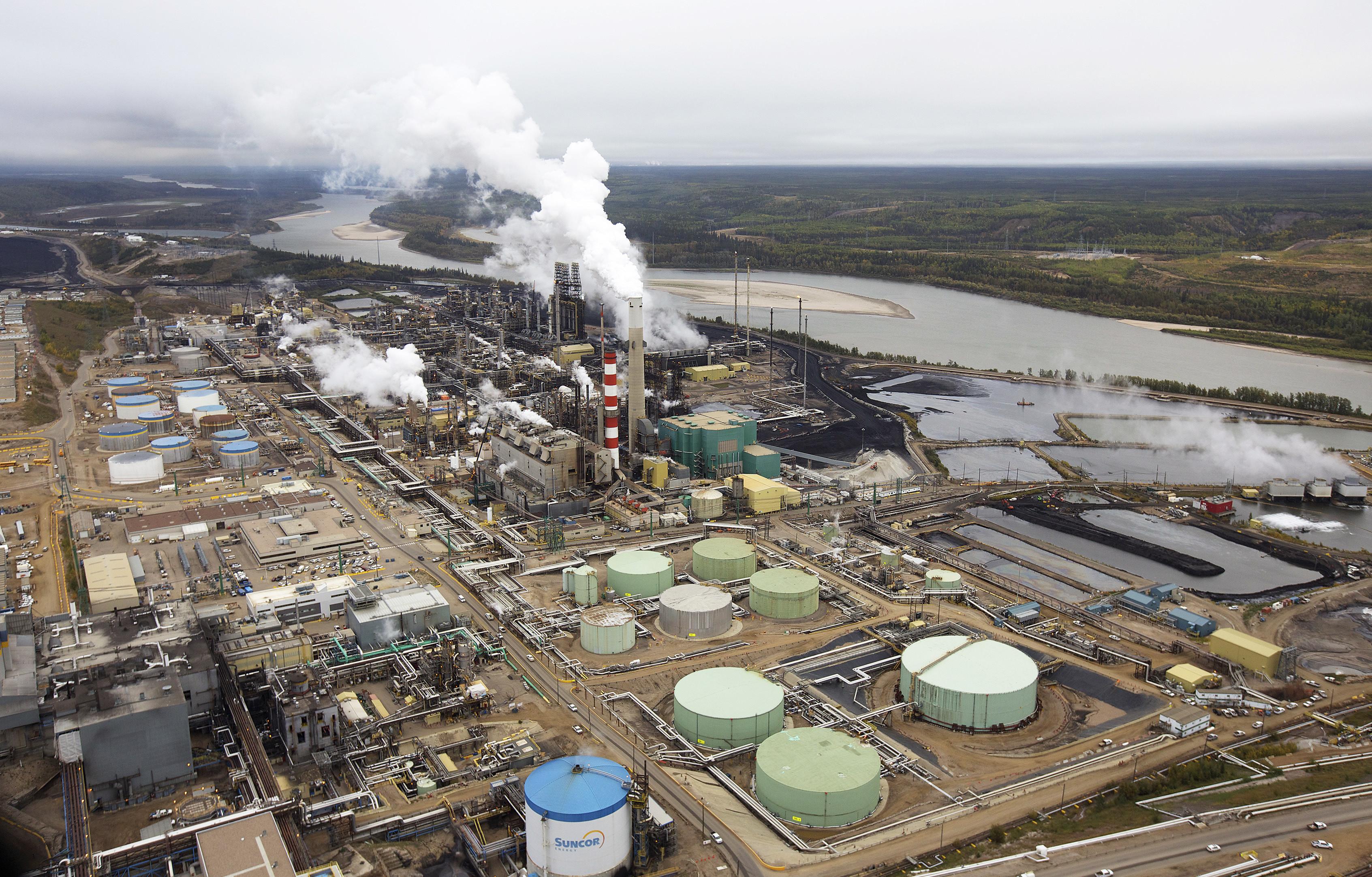 The Suncor oil sands processing plant near the Athabasca River, Alberta, Canada.