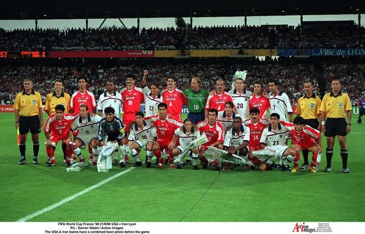 Football - 1998 FIFA World Cup - Group F - Iran v United States of America - Stade Gerland, Lyon - 21/6/98 Pic : Darren Walsh / Action Images  The USA & Iran teams have a combined team photo before the game