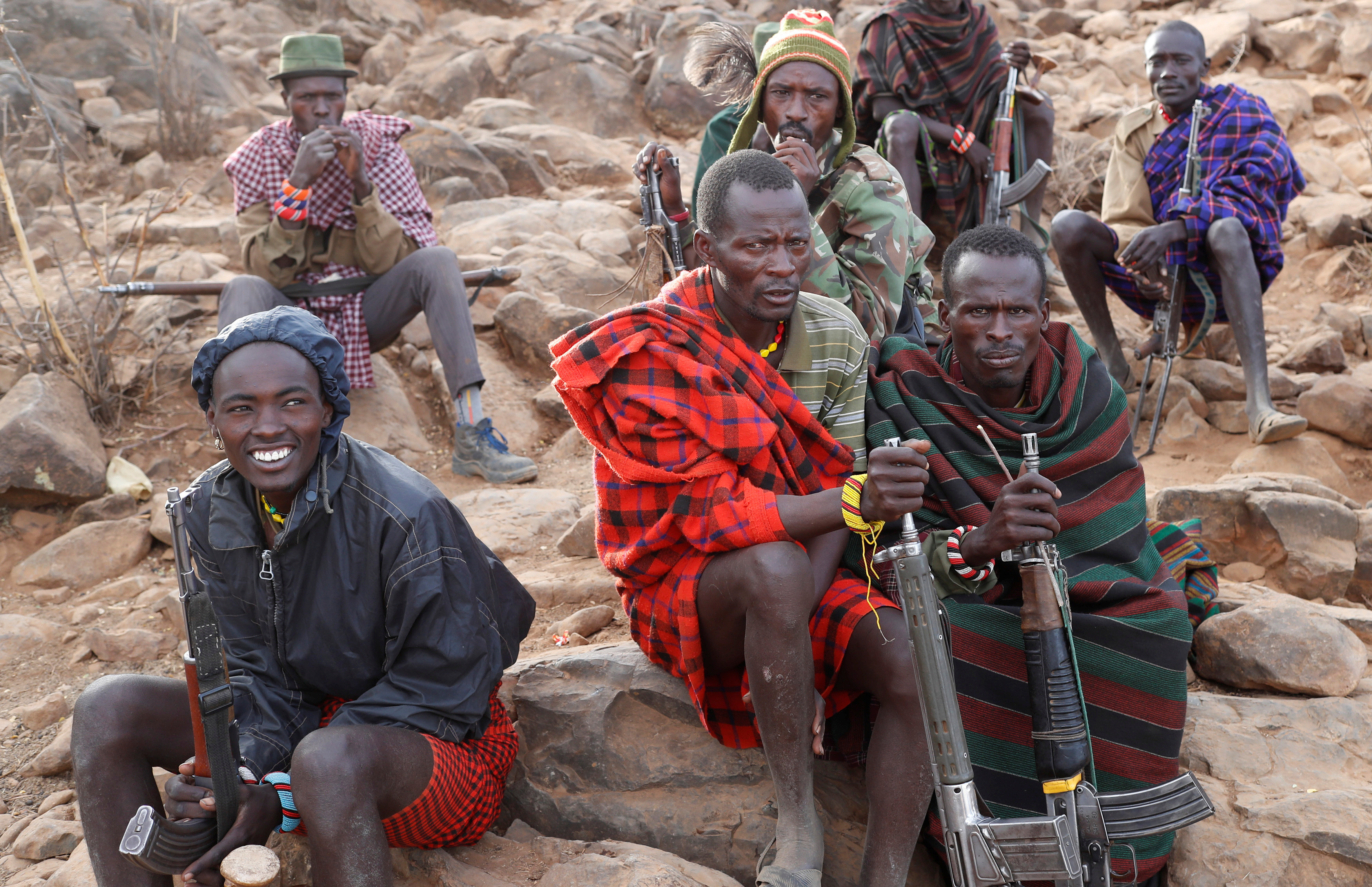 Drought wars … tribesmen protect their cattle close to a borehole in Kenya.