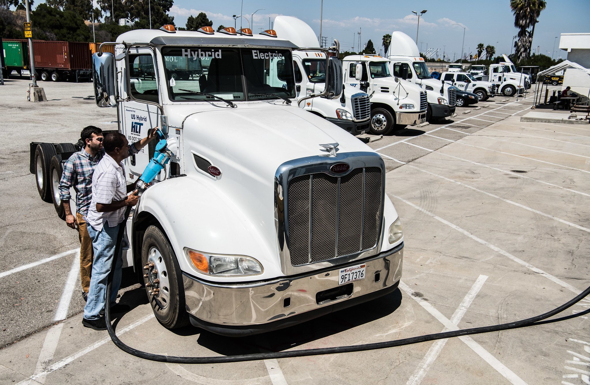 July 31, 2017 -  A  US Hybrid, electric hybrid heavy duty truck, used to move freight at the Long Beach Port in California, is plugged in to charge at TTSI.  (Photo by DENNIS SCHROEDER / NREL)