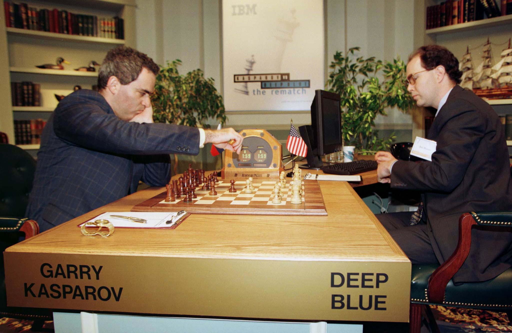 World chess champion Garry Kasparov (L) reaches to make a move early in game six of the six-game $1.1 million chess match series against IBM supercomputer Deep Blue operated by IBM's Joe Hoane (R) in New York, May 11. The supercomputer made chess history when it defeated Kasparov for an overall victory in their six game re-match, the first time a computer has triumphed over a reigning world champion in a classical match. Kasparov resigned after 19 moves.CHESS DEEPBLUE - RTR3MU9