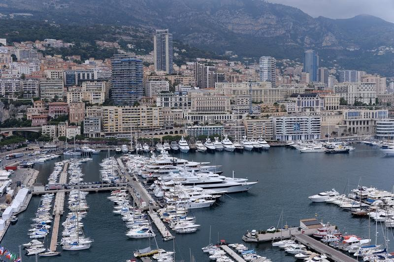 A general view shows luxury boat in the port and buildings in Monaco, June 24, 2014. Police investigating the shooting last month of Monaco heiress Helene Pastor in Nice have discovered what they said were 'suspicious' financial transactions on bank accounts belonging to her son-in-law, a prosecutor said on Tuesday. Pastor, who belongs to one of Monaco's richest families, died following a May 6 shooting outside a hospital in Nice where her driver was also shot and killed.    REUTERS/Patrice Masante (MONACO - Tags: BUSINESS CRIME LAW REAL ESTATE) - PM1EA6O172J01