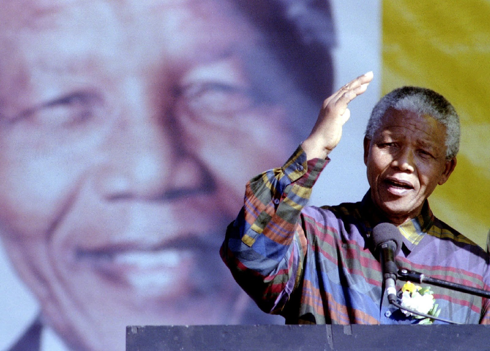 President Nelson Mandela addresses a rally in this township near Pretoria, June 25. He said he wanted the country's rugby union team to be allowed to keep its springbok emblem, despite its apartheid origins. The team, which won the rugby union World Cup, was due to be given a new emblem - PBEAHUNCBAU
