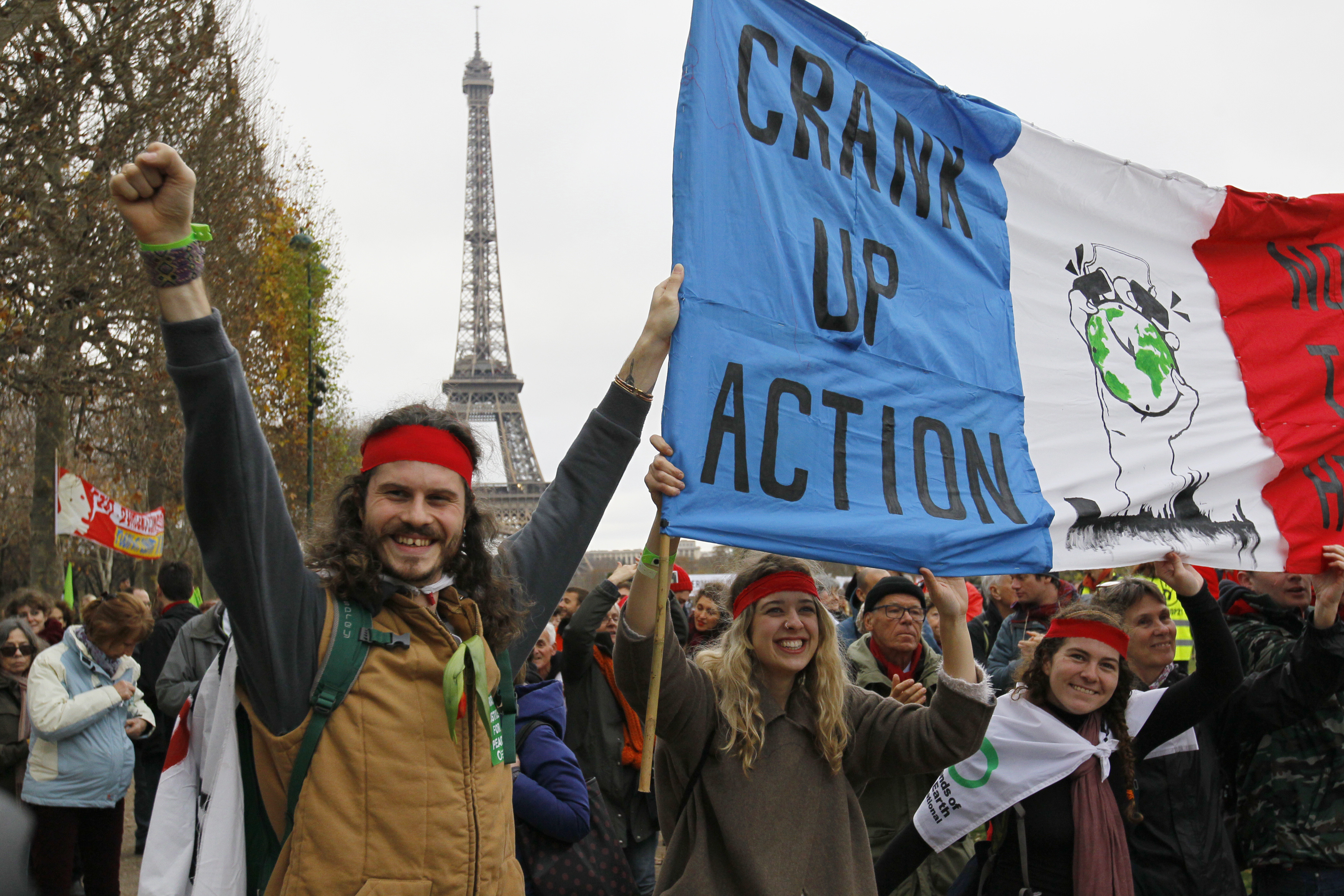 Environmentalists hold a banner which reads, crank up action