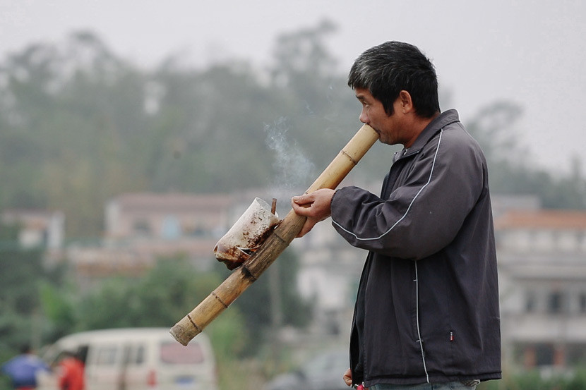 A villager stops for a postprandial smoke in Cangdong Village, Guangdong province.