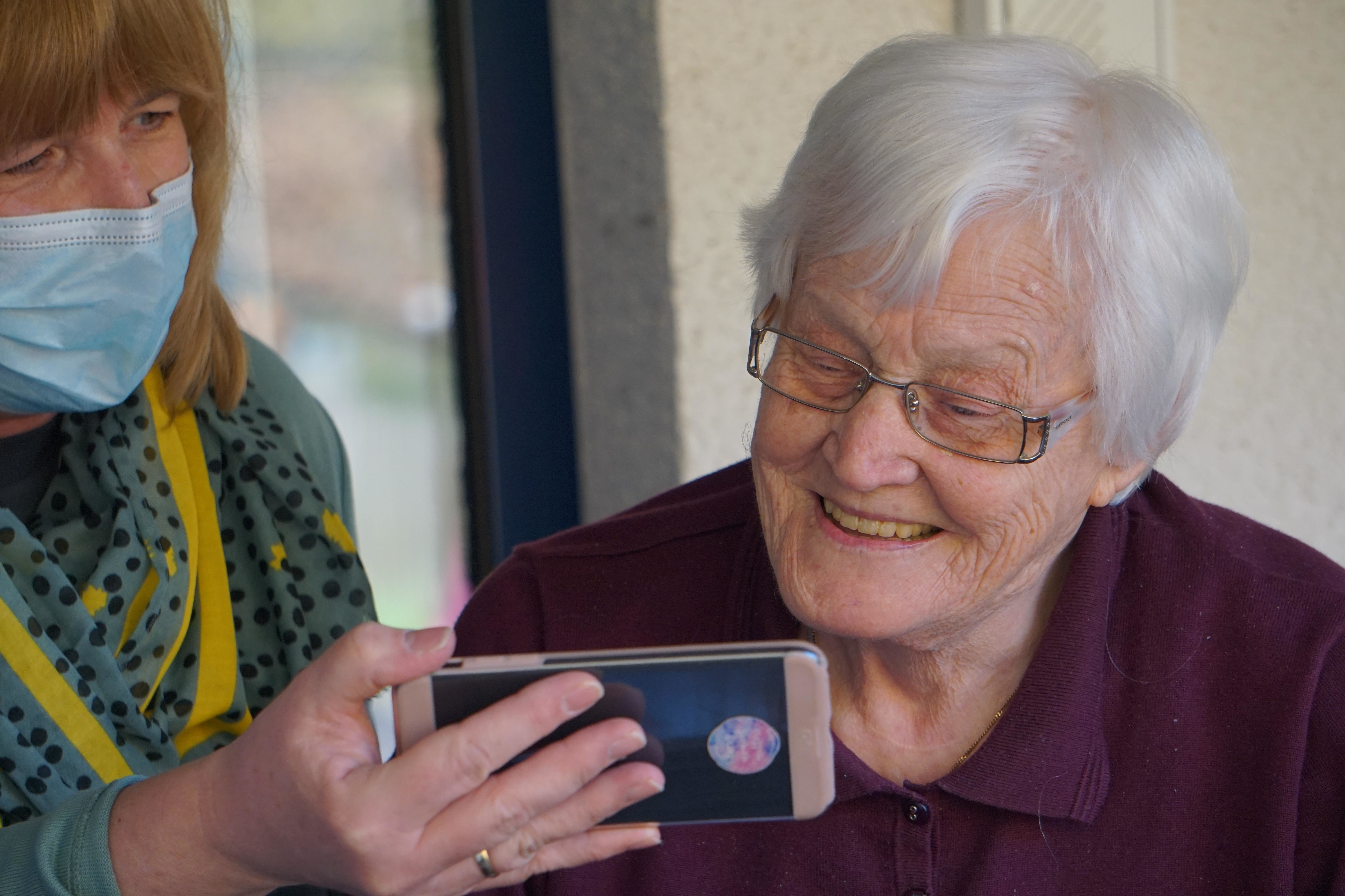elderly woman with a smart phone during COVID-19