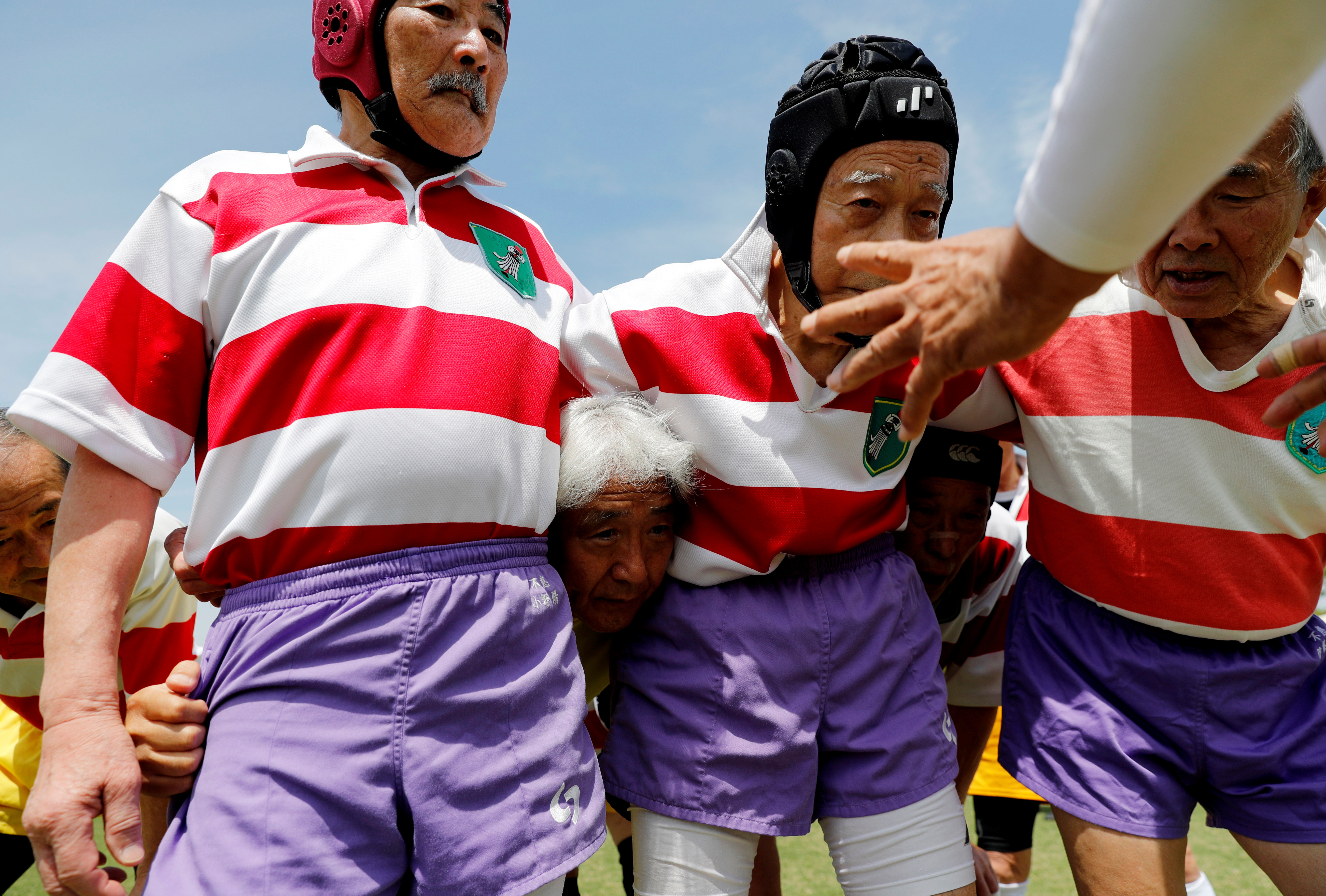 Ryuichi Nagayama, 86, Fuwaku Rugby Club's oldest active player, practices before a match in Kumagaya, Saitama Prefecture, Japan, May 3, 2019.