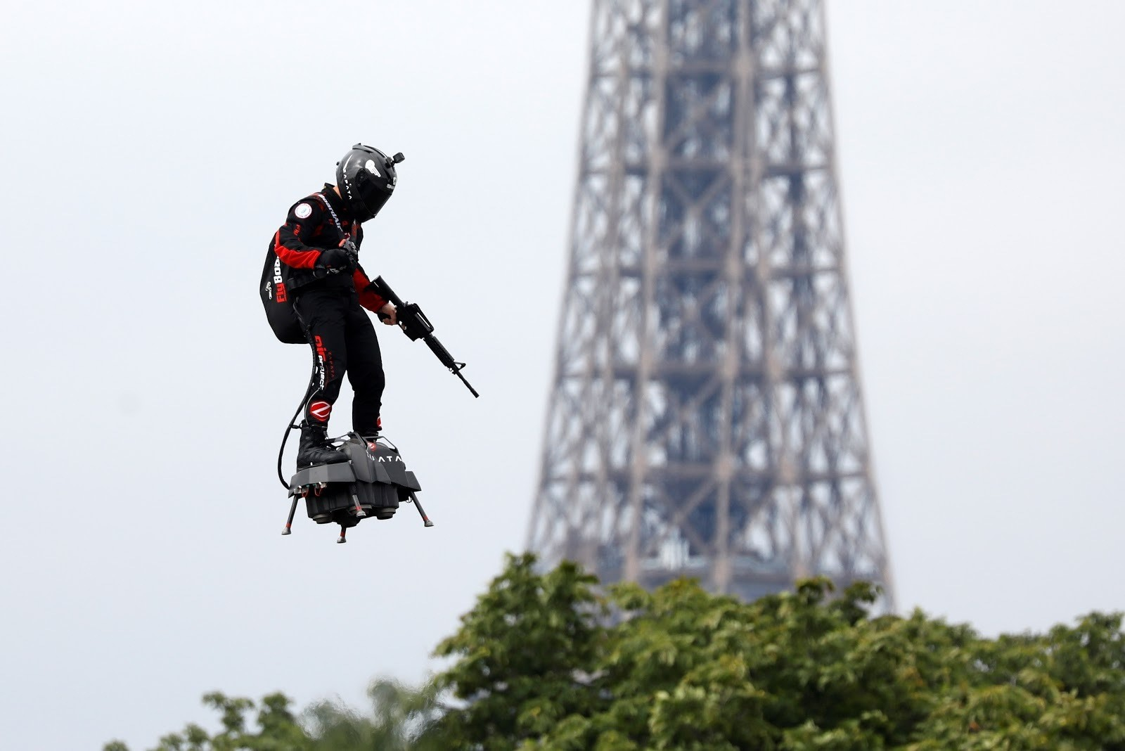 Franky Zapata flies on a Flyboard near the Eiffel Tower during the traditional Bastille Day military parade on the Champs-Elysees Avenue in Paris, France, July 14, 2019. REUTERS/Charles Platiau - RC1FB782DD00