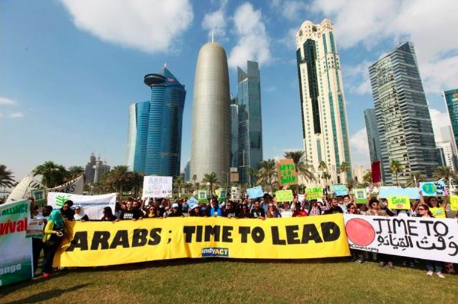 Activists from the Arab Youth Climate Movement participating in a climate change March in downtown Doha, Qatar