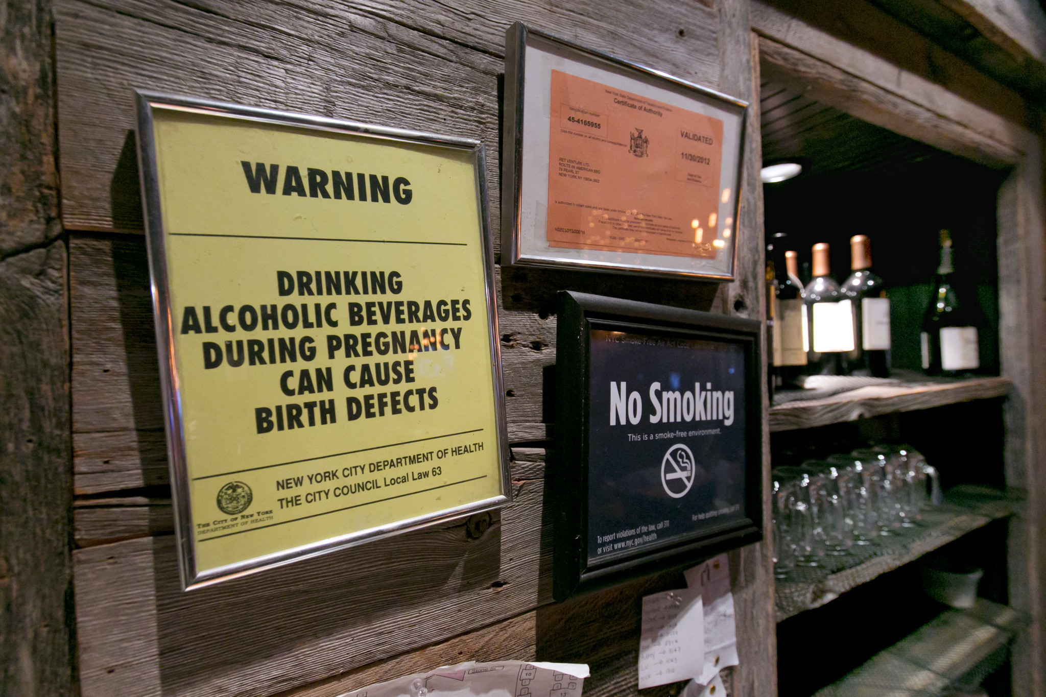 Signs in a New York bar warn of the dangers of drinking while pregnant.