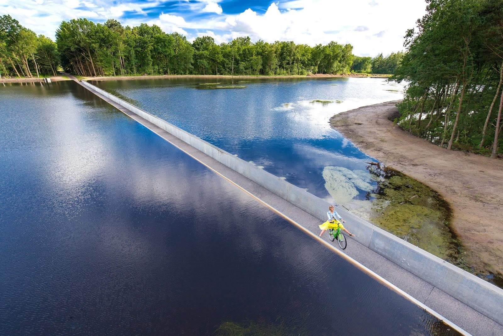 Cycling Through Water, is a three-metre-wide track in Belgium with water at eye-level on both sides