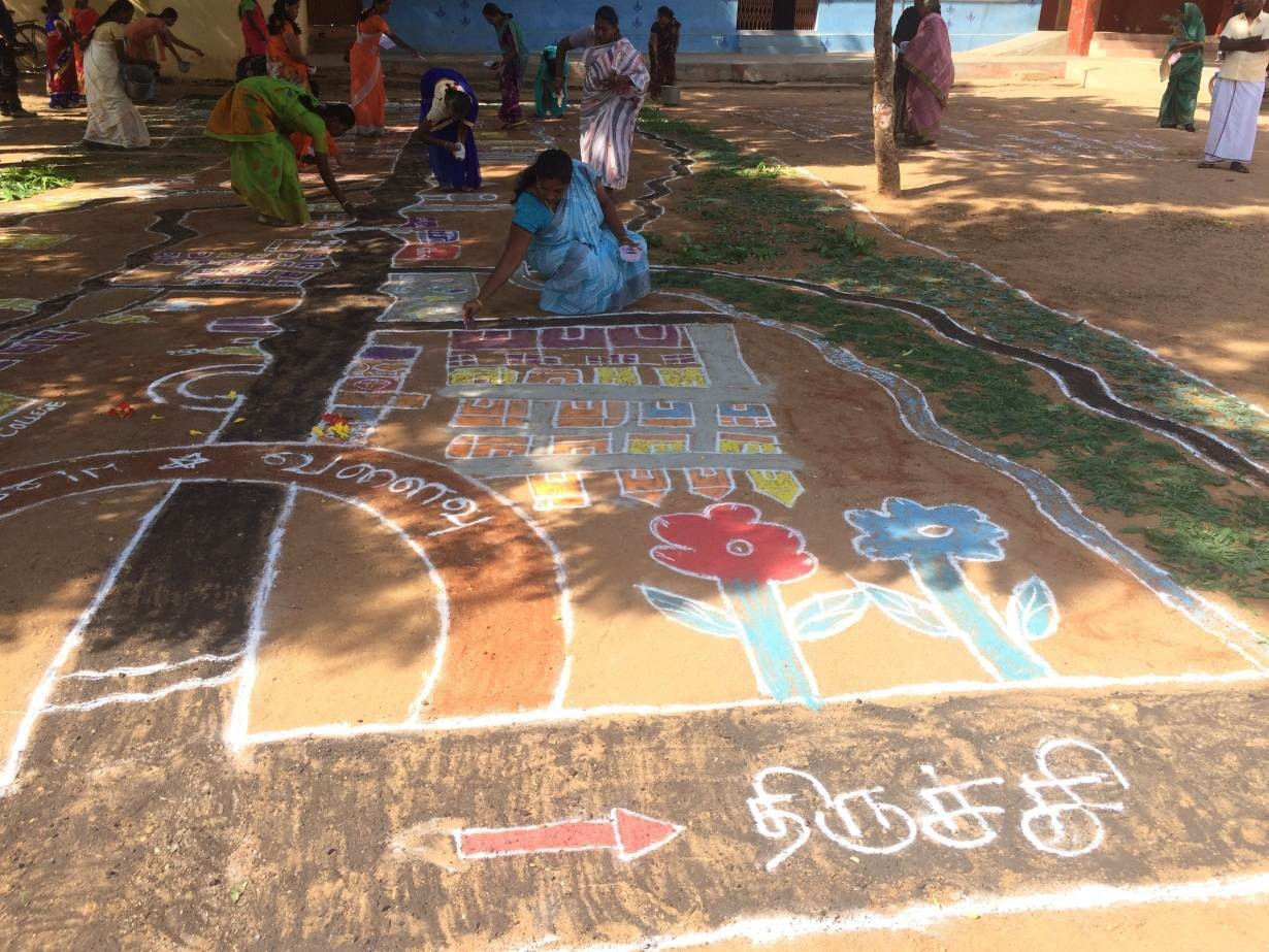 Women drawing a community map using the kolam art form in Ayyampatty in southern state of Tamil Nadu, India July 14, 2019.