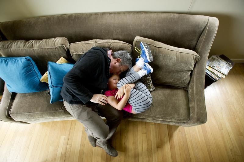 Ellie Mowry-Silverman, 6, spends time with one of her two fathers, Joe Silverman, in Sausalito, California June 23, 2013.