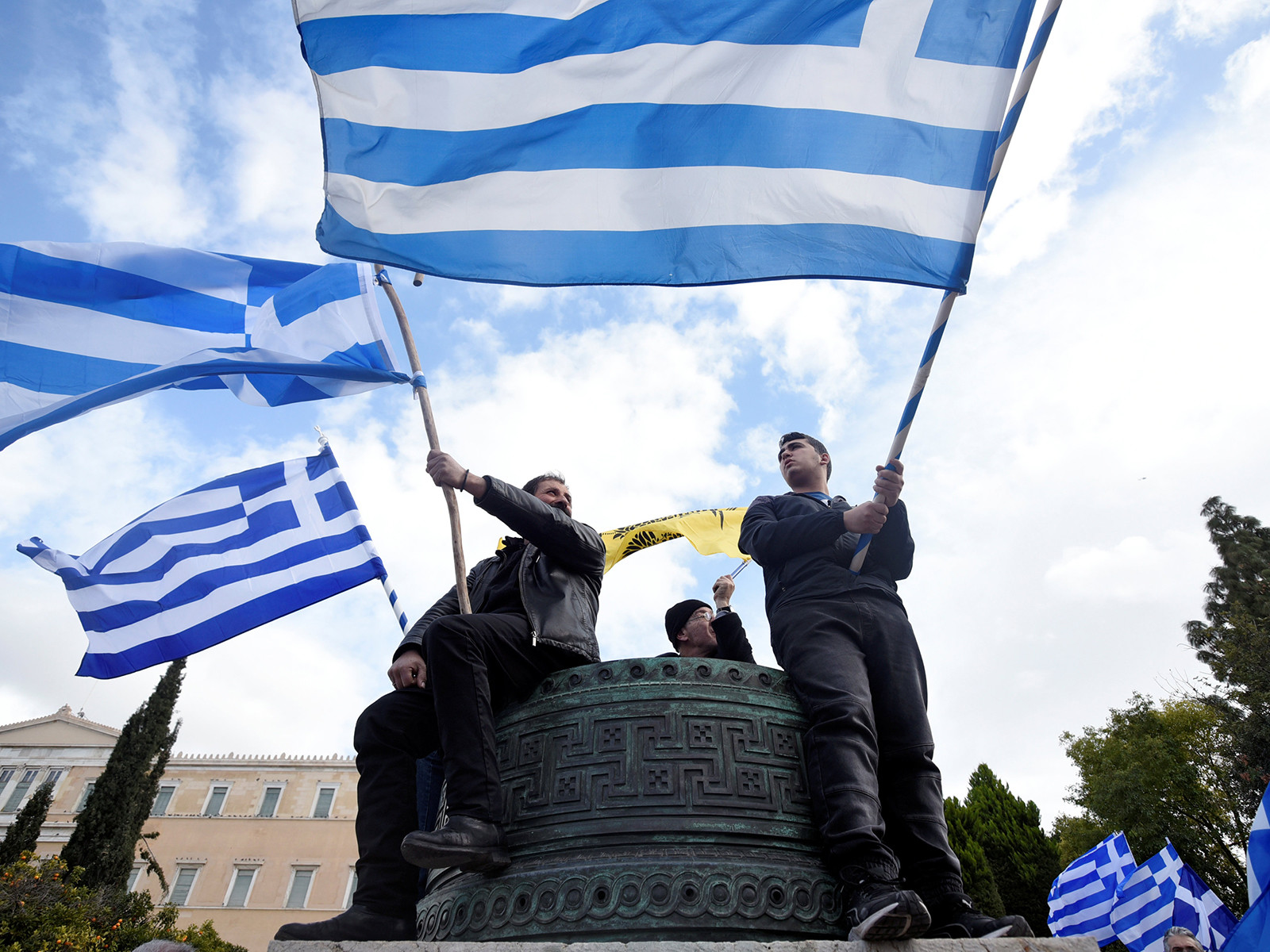 Protesters waving Greek flags take part in a demonstration against the agreement reached by Greece and Macedonia to resolve a dispute over the former Yugoslav republic's name, in Athens, Greece, January 20, 2019. REUTERS/Alexandros Avramidis