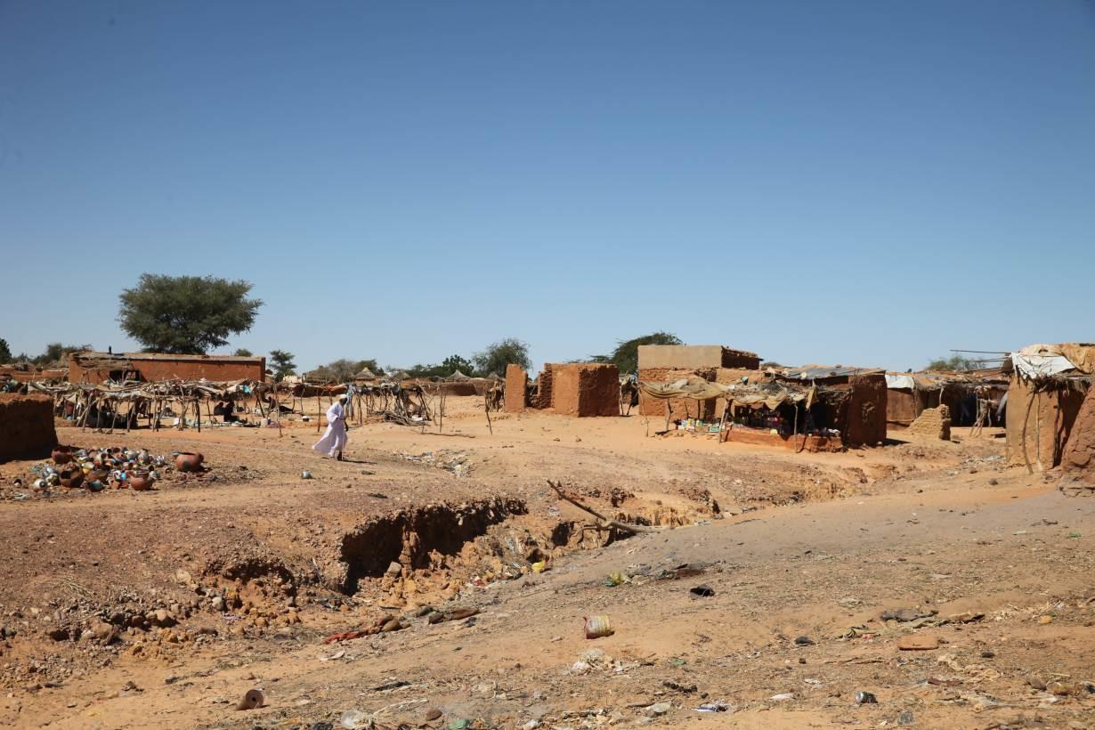 A man walks through Touloum refugee camp in Iriba, Chad, November 27, 2019