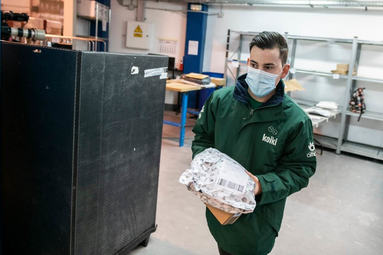 shown here is Koiki worker sorting through parcels at the Madrid centre in Spain. February 2021.