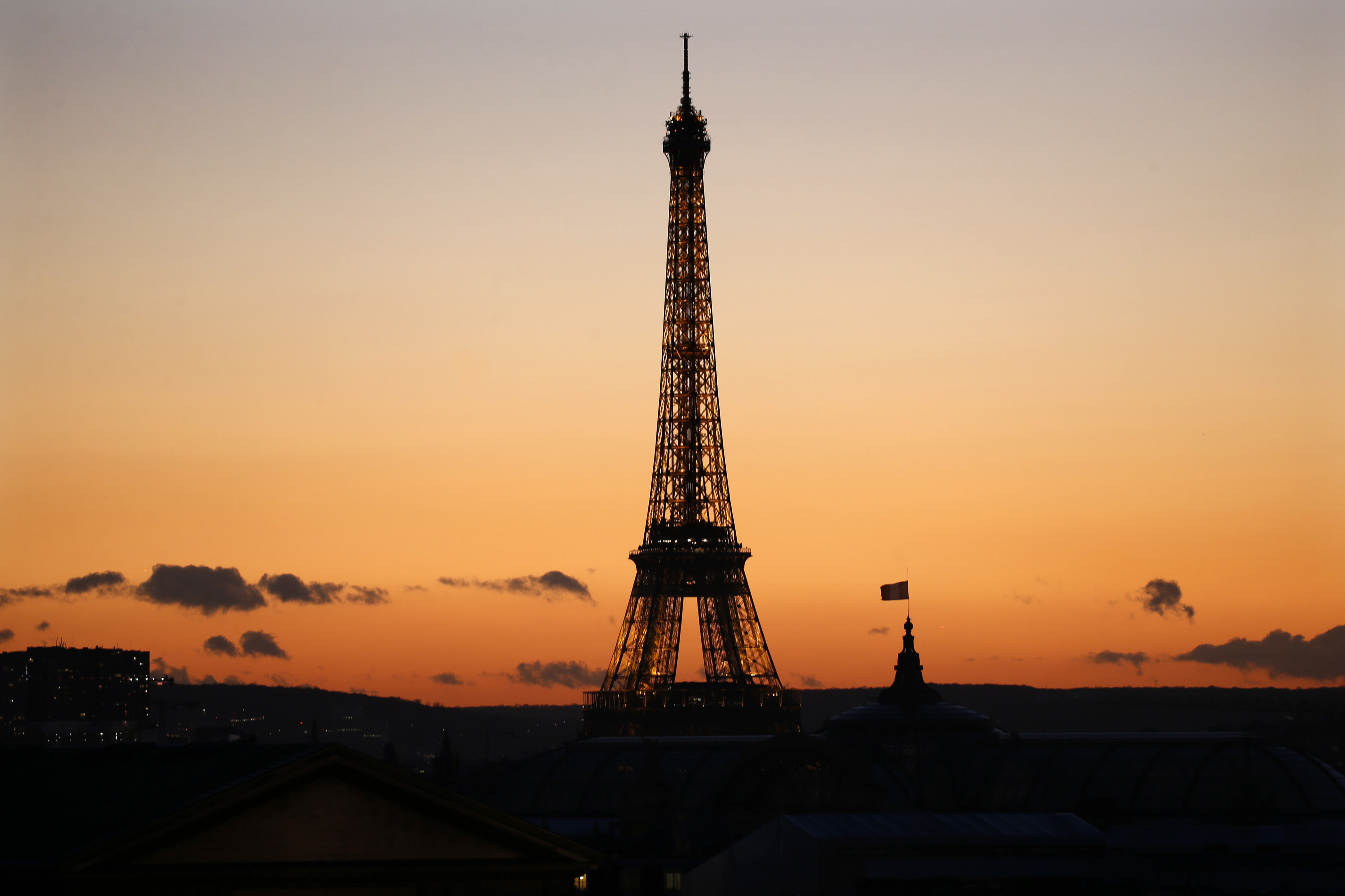 The Eiffel Tower is seen in silhouette at sunset on a winter day in Paris, France, January 15, 2016.