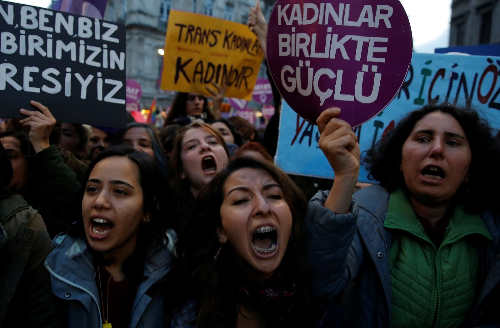 Women's rights activists march through Istanbul's Taksim Square to protest against gender violence.