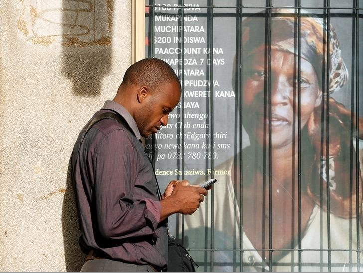 Checking a mobile phone in the Zimbabwean capital Harare.