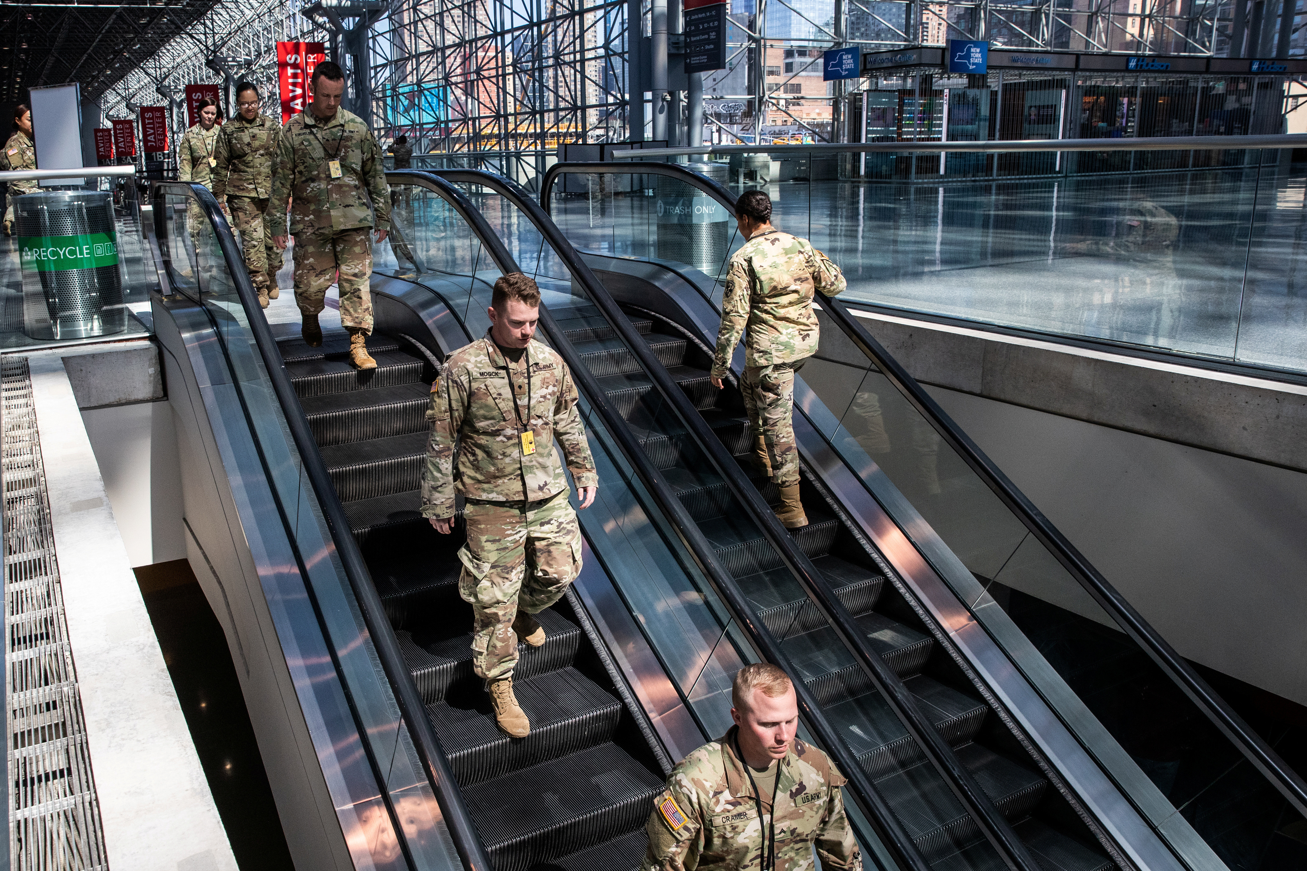 U.S. Army personnel are seen at the Jacob K. Javits Convention Center, which will be partially converted into a hospital for patients affected by the coronavirus disease (COVID-19) in Manhattan in New York City, New York, U.S., March 27, 2020. REUTERS/Jeenah Moon - RC2ISF9RFXJC