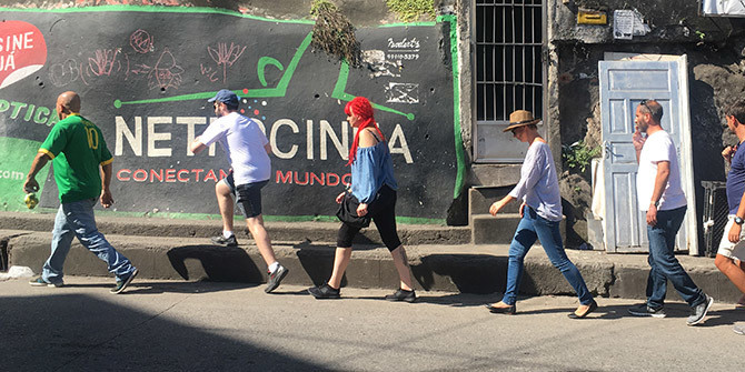 Tourists head into Rocinha on on a walking tour organised by local entrepreneurs