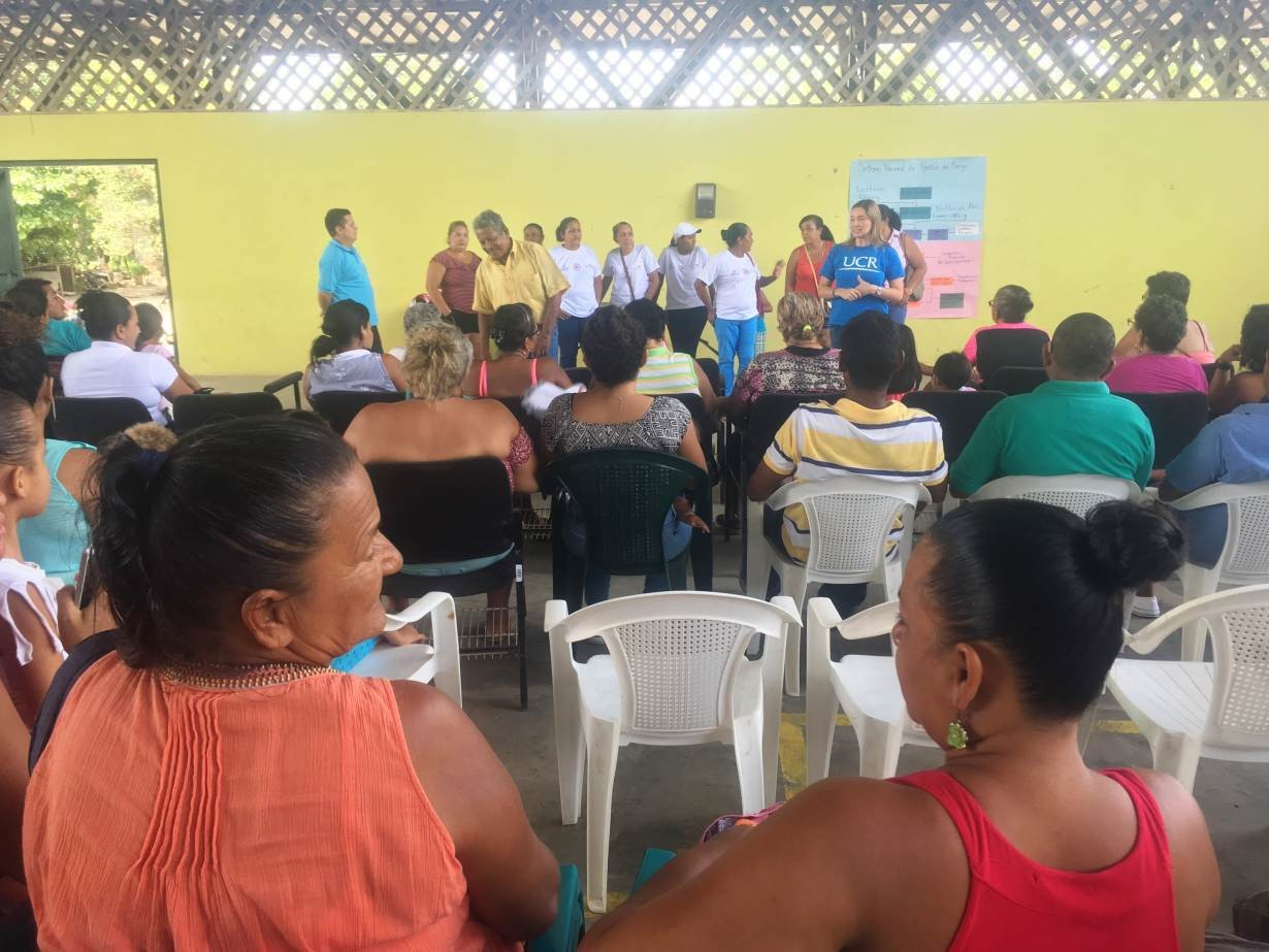 Community members in Corralillo, in Guanacaste, Costa Rica, talk about mental health issues and resilience to risks at the town's main shelter, June 30, 2018.