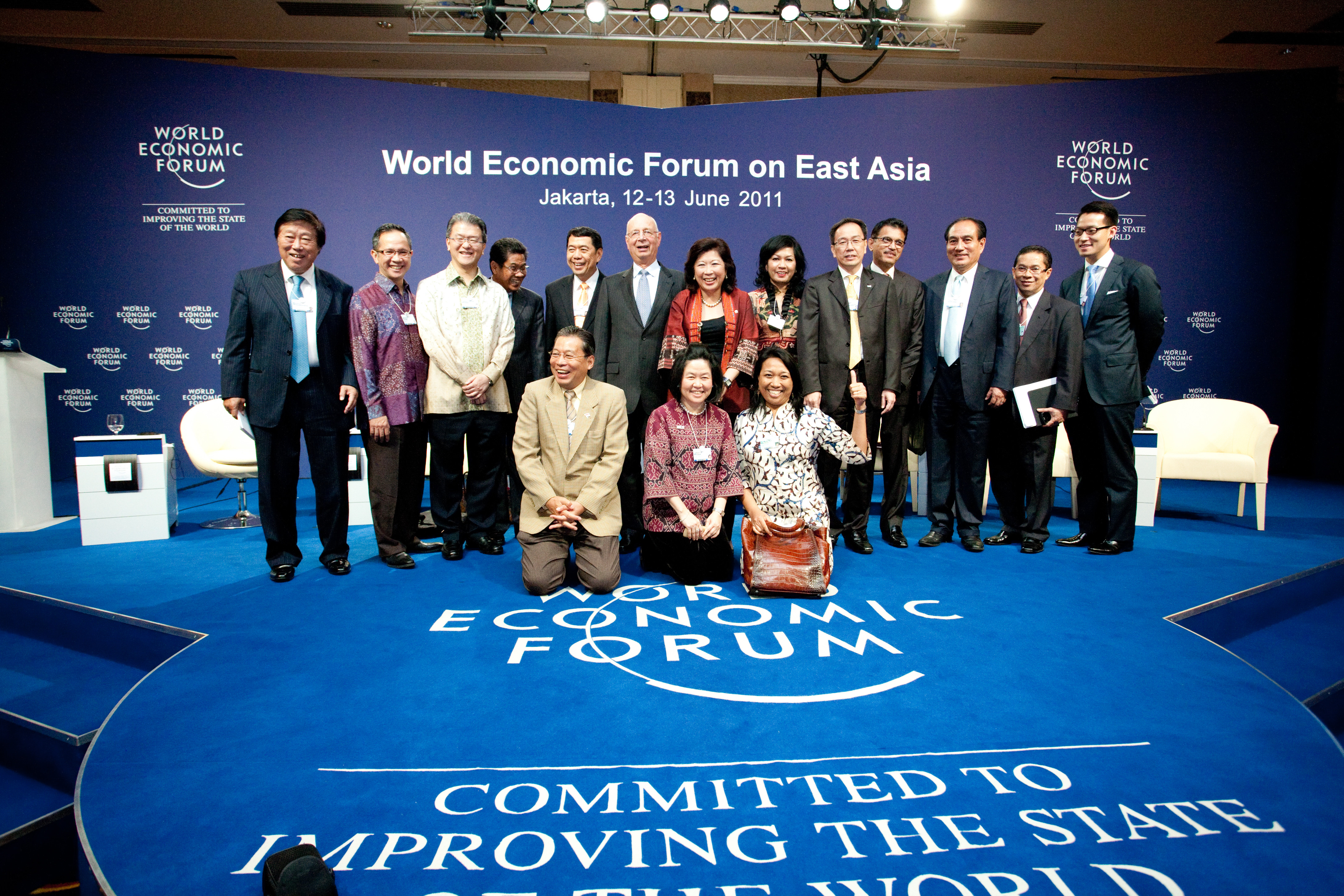 Klaus Schwab, Executive Chairman, World Economic Forum pose together with Organizing Committee members after the Closing Ceremony