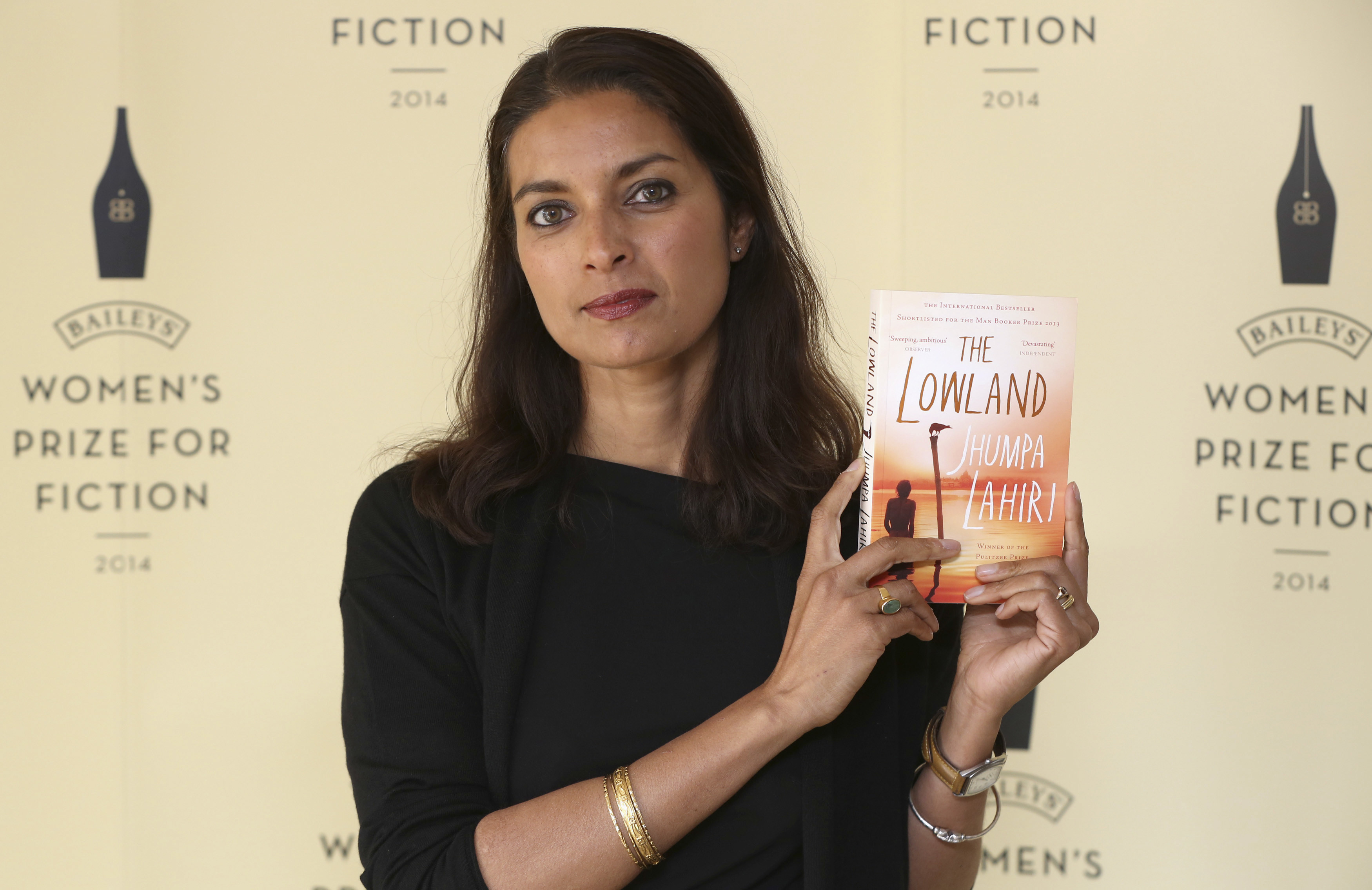Author Jhumpa Lahiri poses with her novel