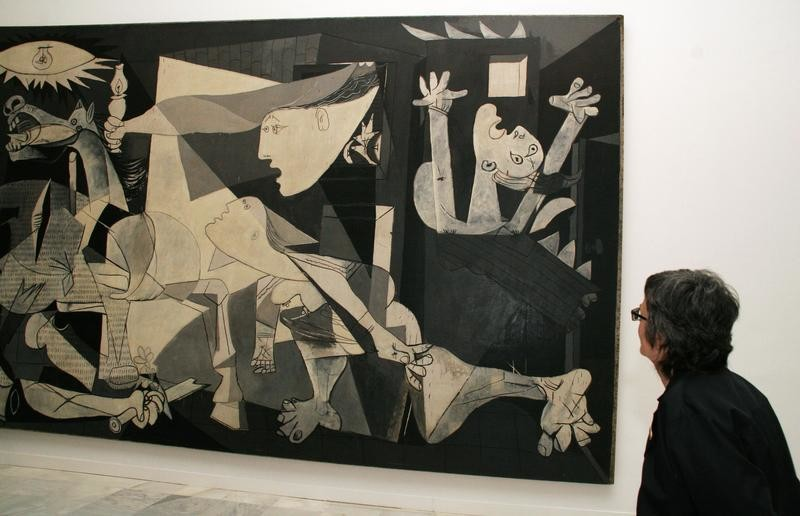 A woman looks at Spanish artist Pablo Picasso's