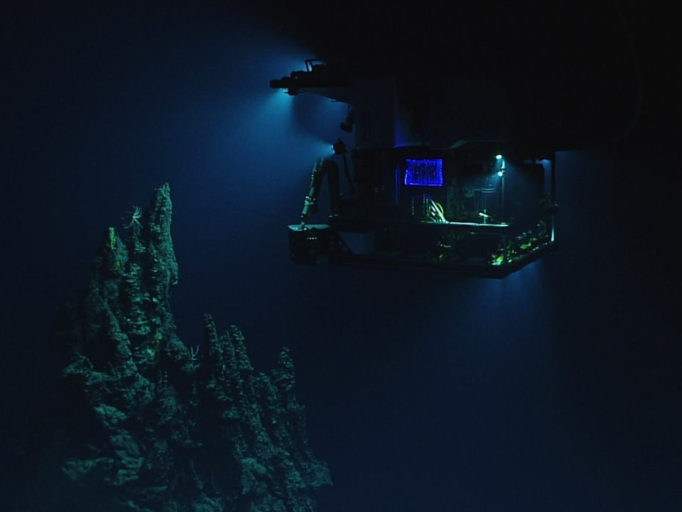 A remotely operated vehicle Deep Discoverer surveys a 46-foot hydrothermal chimney during a deepwater exploration of the Marianas Trench.