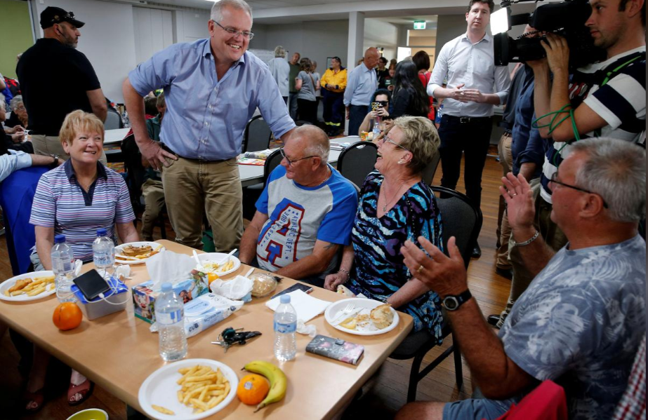 Australia's Prime Minister Scott Morrison talks to locals during a visit to Club Taree Evacuation Centre in Taree, New South Wales.