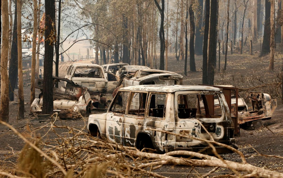 A cluster of burnt out cars sit at a property at Rainbow Flat, Australia, November 11, 2019. AAP Image/Darren Pateman/via REUTERS