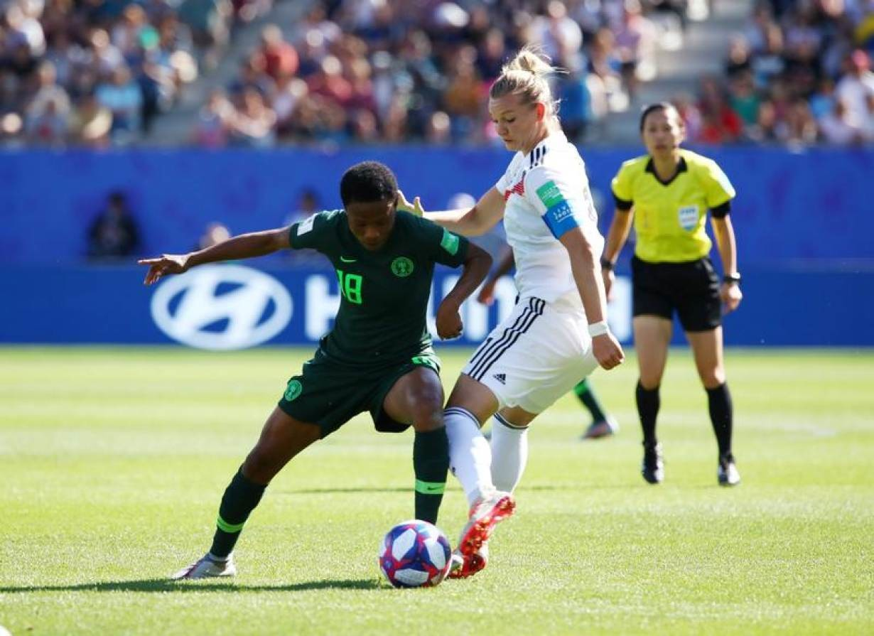 Soccer Football - Women's World Cup - Round of 16 - Germany v Nigeria - Stade des Alpes, Grenoble, France - June 22, 2019 Nigeria's Halimatu Ayinde in action with Germany's Alexandra Popp