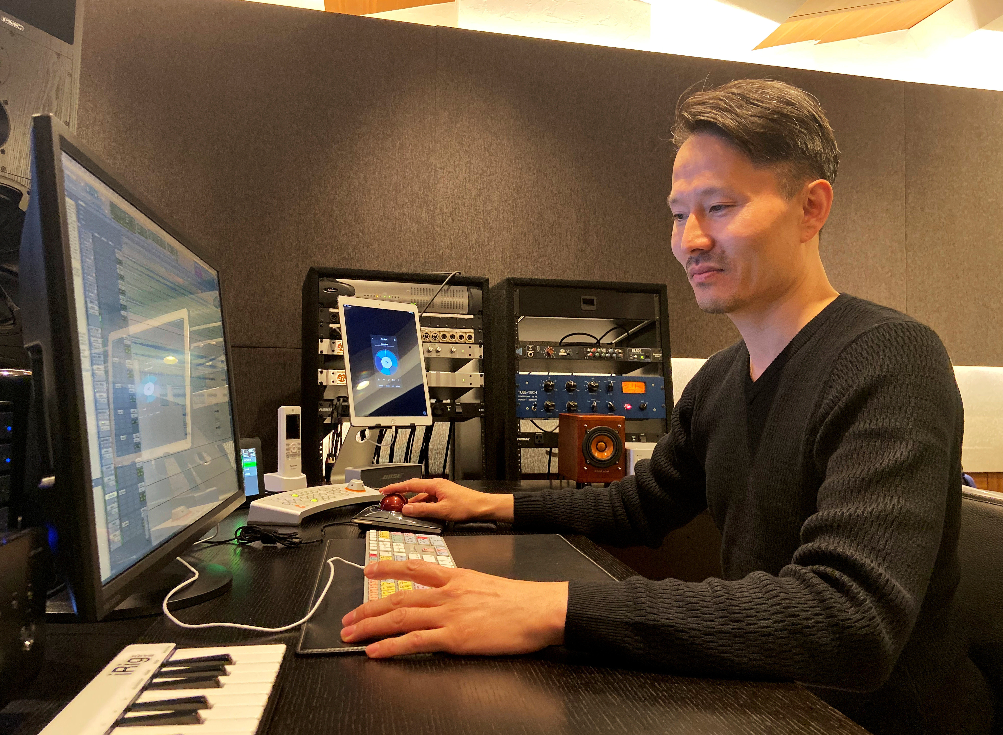 Jun Inoue, a producer who created a theme song for Pope Francis' upcoming visit to Japan, demonstrates his work at his studio in Tokyo.