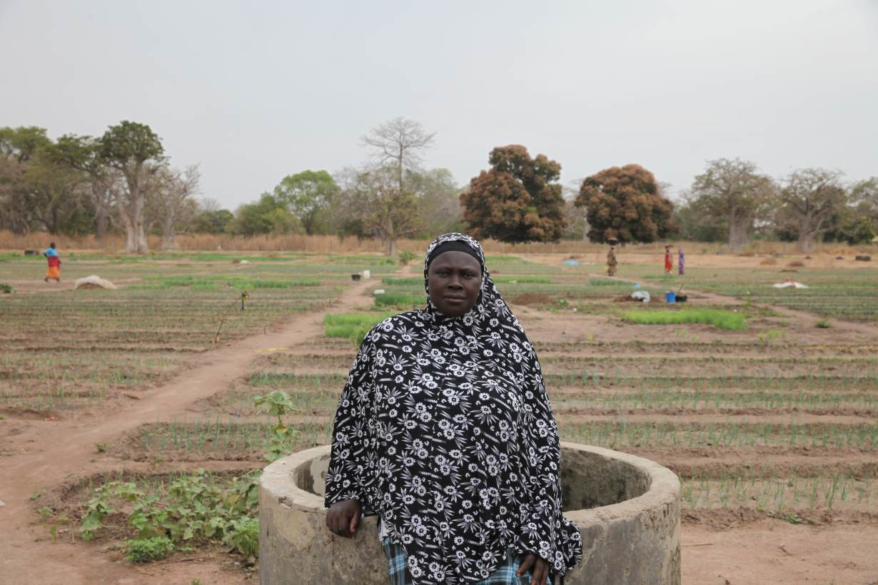Farmer Sirreh Samateh poses for a portrait in the communal vegetable garden in the village of Jali, Gambia, January 23, 2020.
