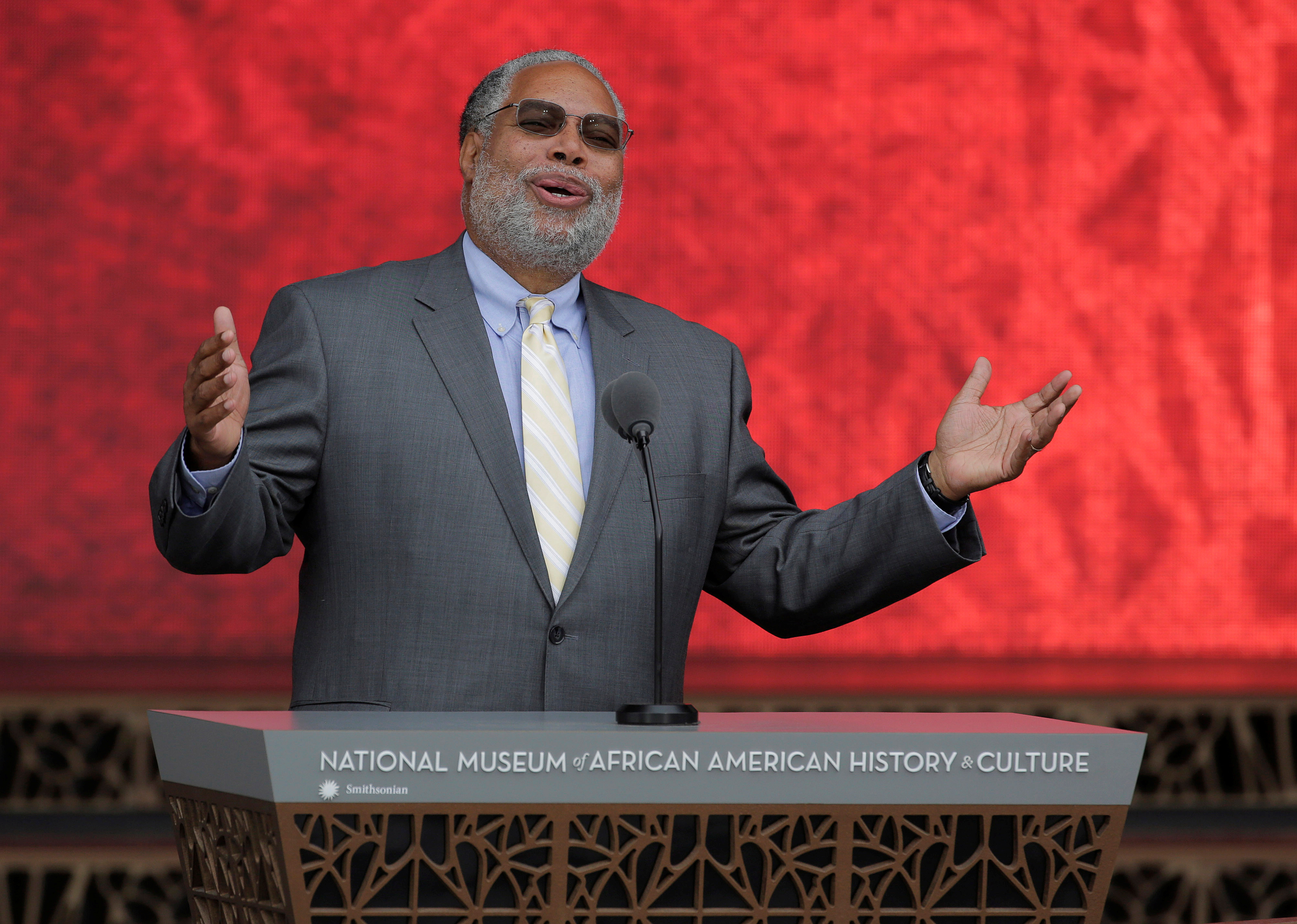 Lonnie Bunch, director of the Smithsonian's National Museum of African American History and Culture, speaks during the dedication of the museum in Washington, U.S., September 24, 2016. REUTERS/Joshua Roberts - S1AEUDEBSQAA