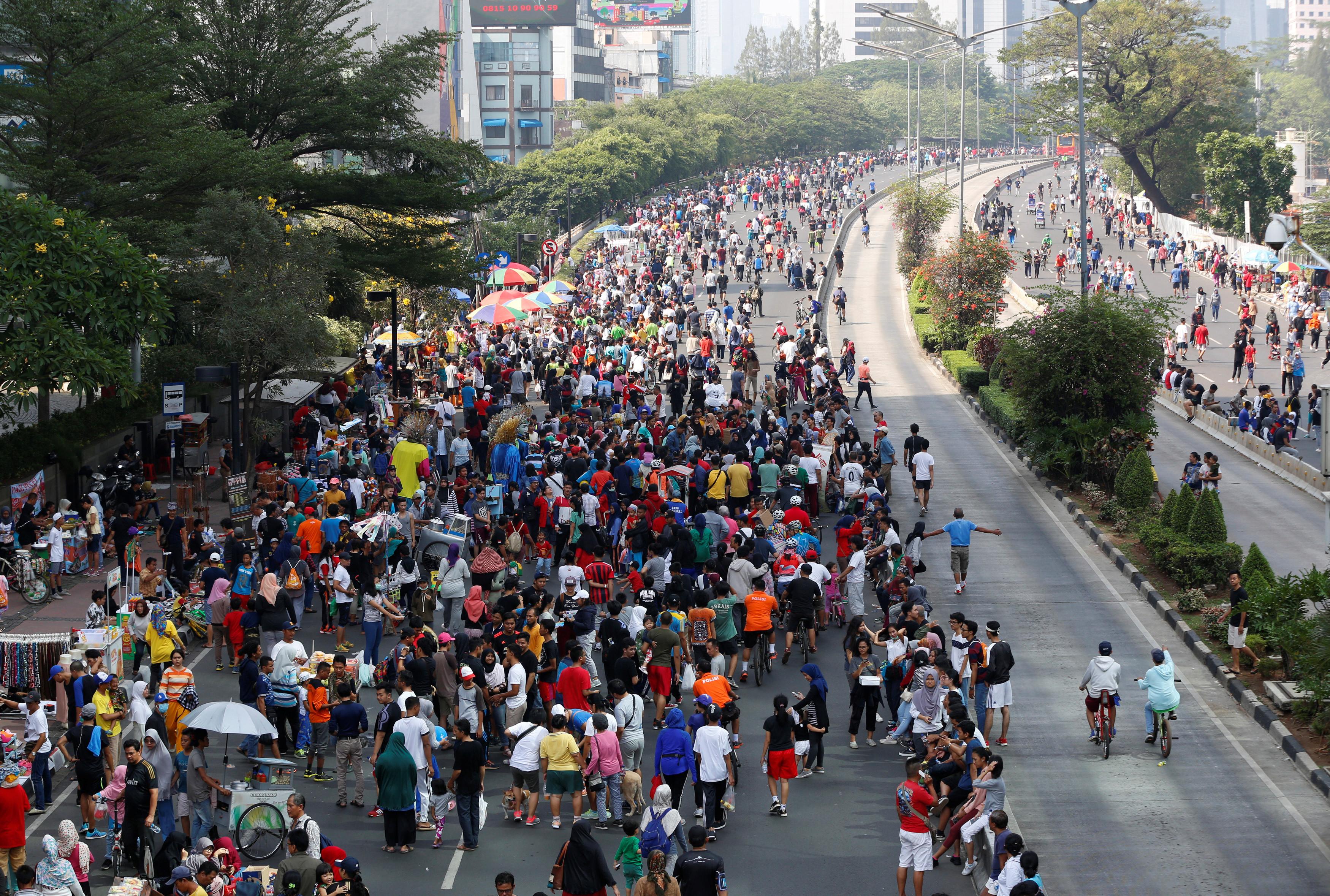 people walk in cities