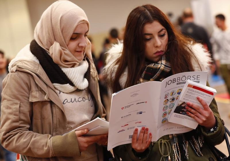 Two women visit the second job fair for migrants and refugees in Berlin, Germany, January 25, 2017.