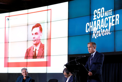 Bank of England governor Mark Carney presents the image of mathematician Alan Turing who will appear on a new 50 pound note at the Science and Industry Museum in Manchester, Britain, July 15, 2019. REUTERS/Andrew Yates - RC12C30FD230