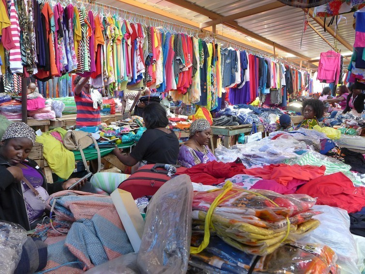 Angolan female trader selling wares from Brazil and China in Luanda's Africampo market